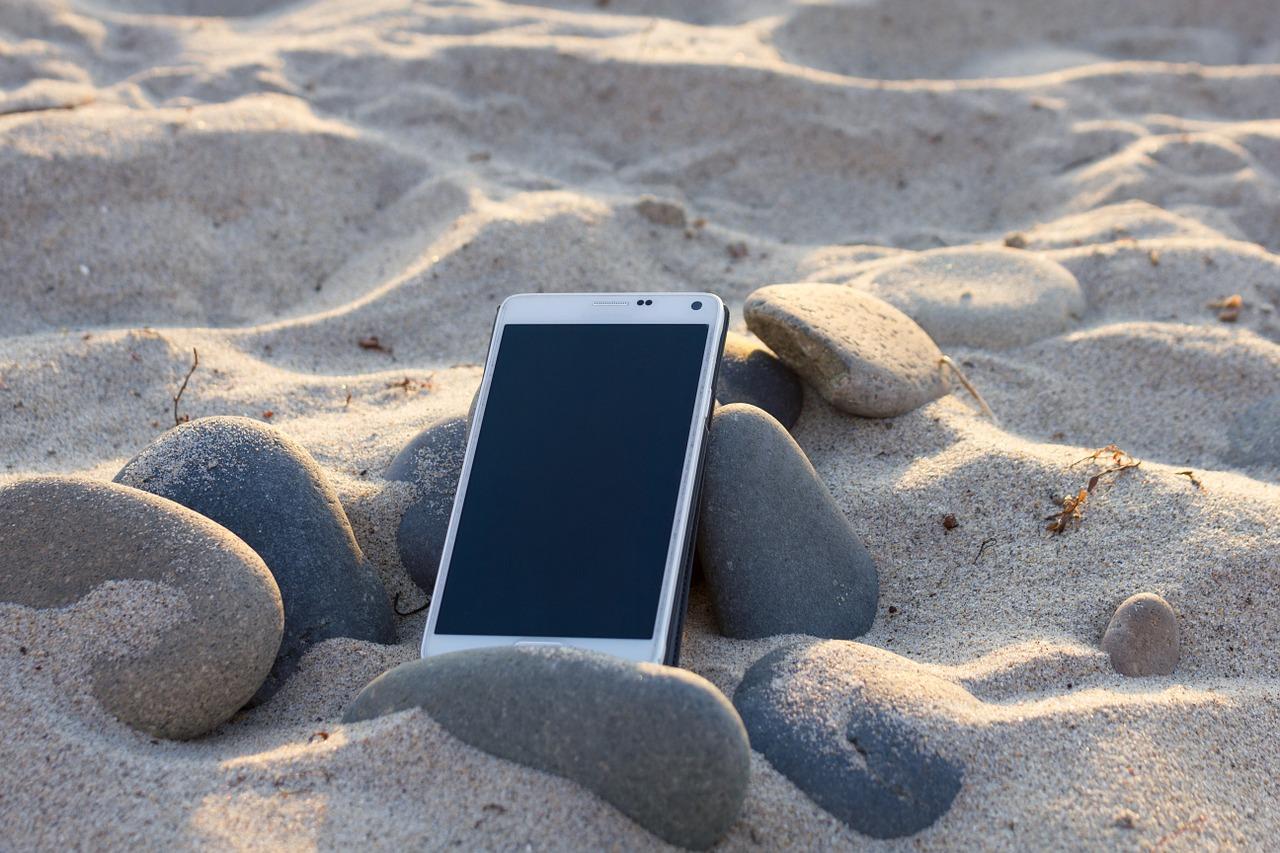 smartphone in sand