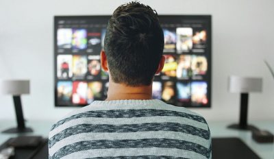man watching tv