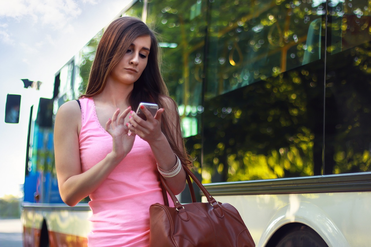 woman using smartphone while traveling
