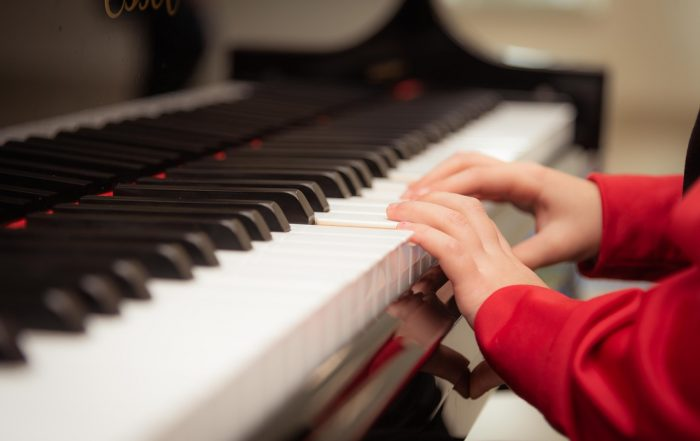 person learning piano